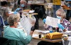Ramsey County election judges process early voting ballots in October 2020.