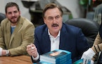 Mike Lindell signed copies of his new book at the Shakopee factory of his MyPillow business last year.