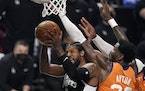 Clippers guard Paul George shot as Suns center Deandre Ayton defended during the second half in Game 3 of the Western Conference finals Thursday.