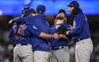 The Cubs celebrated a combined no-hitter between four pitchers after the final out by reliever Craig Kimbrel, second from right, in a 4-0 victory over