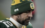 Aaron Rodgers walks off the field after the NFC championship game loss to Tampa Bay.