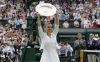 Simona Halep holds the trophy after defeating United States' Serena Williams in the 2019 Wimbledon final.