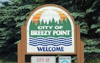 A Breezy Point council member has resigned after being indicted for stock fraud.
