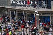 Fans filed into Target Field on Saturday before the game was postponed.