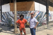 Project Manager Taylor Smrikárova, left, and Executive Director Chris Romano of Redesign, which has acquired the riot-damaged Coliseum building on 27