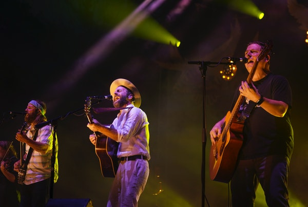 Trampled By Turtles members, including, from left, Dave Carroll, Dave Simonett, and Tim Saxhaug, tore into the first song of their set in just their s