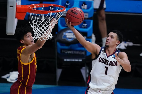 Jalen Suggs (right) is projected to be a top-five pick in the July 29 NBA Draft.