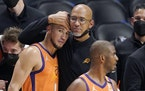 Suns coach Monty Williams hugged Devin Booker, left, as Chris Paul stood by as time runs out in Game 6 of the Western Conference finals against the Lo