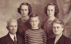same husband, years apart Identical twin sisters Lorraine and Florraine Hoffman, back row, left and right, with their family. Gerald Williams married