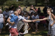 Eve and Michael Brafford danced with their 21-month-old son, Leif, during July 4th celebrations at Langford Park in St. Paul.