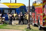 First responders worked at the scene of a fatal Green Line-vehicle crash Sunday afternoon in St. Paul. One person died and another was gravely injured
