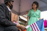 Minneapolis mayoral candidate Sheila Nezhad, right, spoke with Avdi Barre during a Somali Independence Day Festival on Franklin Avenue on Saturday, Ju