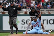 Twins third baseman Luis Arraez called time at second base on Wednesday.
