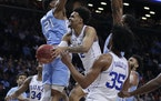 Playing for North Carolina, Sterling Manley (21) faced Duke and Gary Trent Jr. (2) in a 2018 clash.