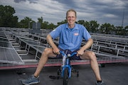 Erik Saltvold, who launched Erik's Bikes from his parents' Richfield garage in 1977, sits on the roof of his company's new, solar-powered headqu