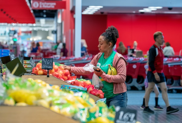 """A Shipt """"shopper,"""" an independent contractor who fulfills orders, picks out food at Target."""