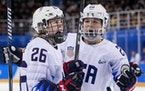 Kendall Coyne Schofield (26) and Hannah Brandt (20) celebrated after a goal against Finland in the 2018 Winter Olympics en route to the gold medal.