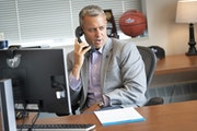 Athletic director Phil Esten has answered the phone and done roughly 999 other things during the school's big jump to Division I.