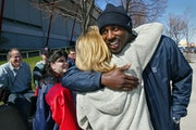 LaTroy Hawkins played with joy, and that earned him an official fan club. Here, while with the Twins in 2002, he hugged Nancy Weber of Hastings, a fan