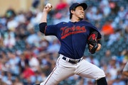 Kenta Maeda pitches against the Tigers at Target Field on Friday