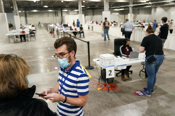 Jason Clusman checked in a patient in April at the Mall of America community COVID-19 vaccination site. While other sites will begin closing, the Bloo