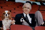 Owner Norm Green and his dogs Charles and Rupert watched a North Stars practice on May 20, 1991, at Met Center.
