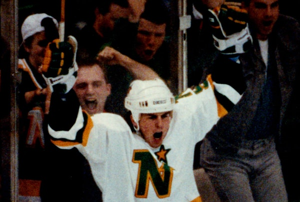 Fans at Met Center celebrated behind North Stars star Mike Modano during Game 3 of the Campbell Conference final against Edmonton, a 7-3 North Stars v