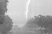 Fans at Hazeltine took cover as lightning (seen in this 1991 photo) touched down.