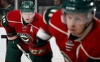"""Ryan Suter, left, and Zach Parise went from """"face of franchise""""-type players to cut."""