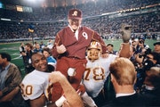 The Washington Redskins carried coach Joe Gibbs off the Metrodome field after the 1992 Super Bowl.