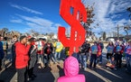 Pressure has been growing for raising pay at the low end of the wage scale. This rally for a higher minimum wage was held at the Minnesota State Capit