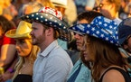 Audience members wear beer-patterned cowboy hats while waiting for Darius Rucker to perform at Mystic Lake Casino in Prior Lake Friday, June 18, 2021.
