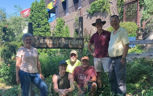 green team Donovan Harmel, far right, and Tom Evers, standing in hat, joined fellow volunteers who keep the public garden in south Minneapolis flouris