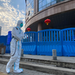 On Feb. 6, 2021 worker in protectively overalls and carrying disinfecting equipment walked outside the Wuhan Central Hospital where Li Wenliang, the w