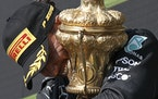 Lewis Hamilton celebrated on the podium after winning the British Grand Prix in Silverstone, England, on Sunday.