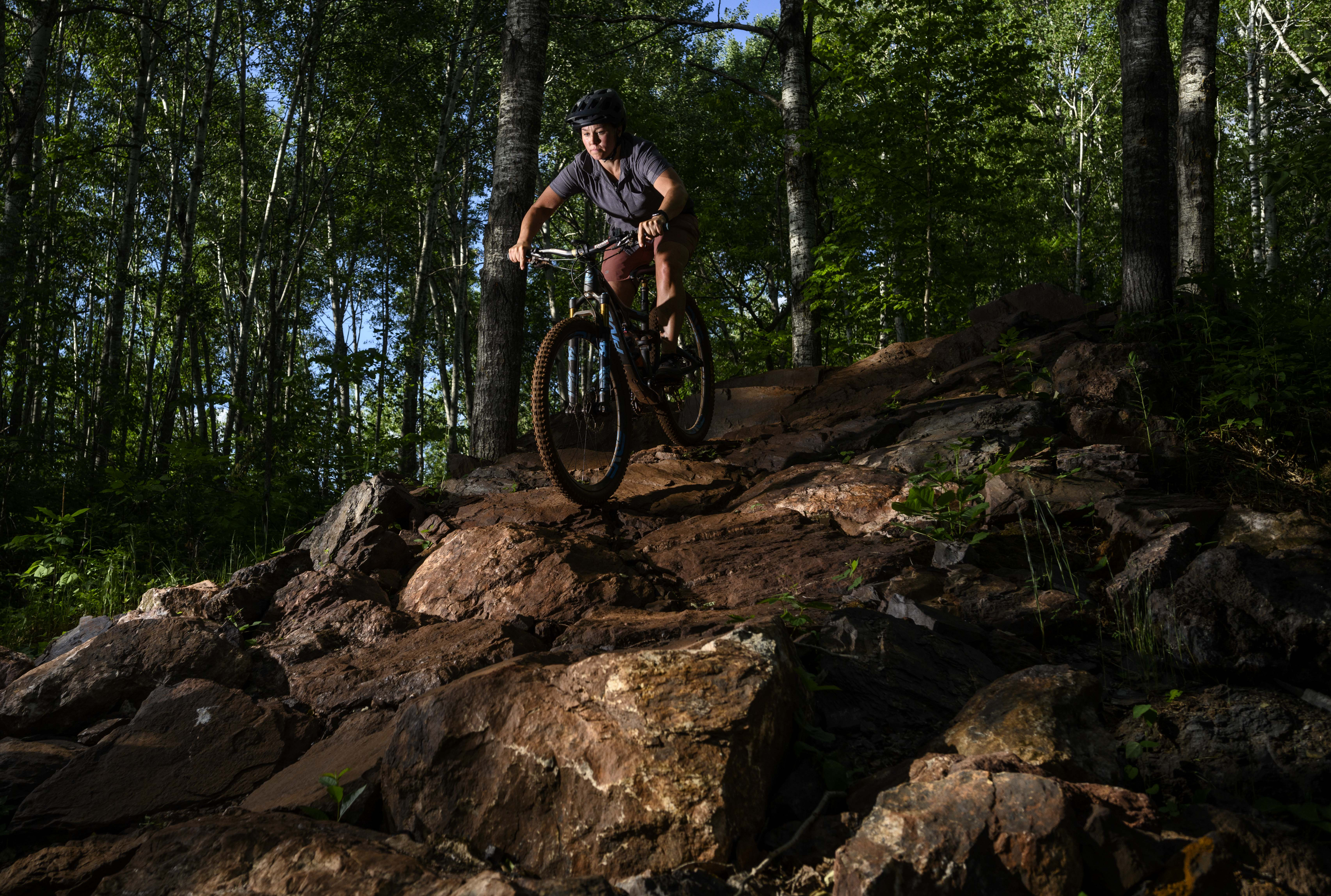 Mari Kivisto navigated a rock wall on the Drawpoint Trail as night came to the Cuyuna Country State Recreation Area.