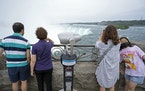 People look out onto the Horseshoe Falls in Niagara Falls, Ontario on Friday, July 16, 2021. Phase 3 of Ontario's COVID-19 opening plan arrived with
