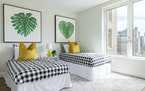 Chartreuse pillows are paired with green in a space, adding a creative pop of citrus.