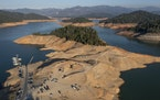 Boats are docked at a marina hundreds of feet from where they are usually moored because water levels at California's Lake Shasta have fallen . (Bri