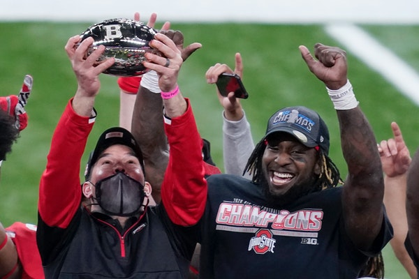 Ohio State coach Ryan Day, left, and running back Trey Sermon celebrated after the Buckeyes defeated Northwestern in the 2020 Big Ten Championship Gam