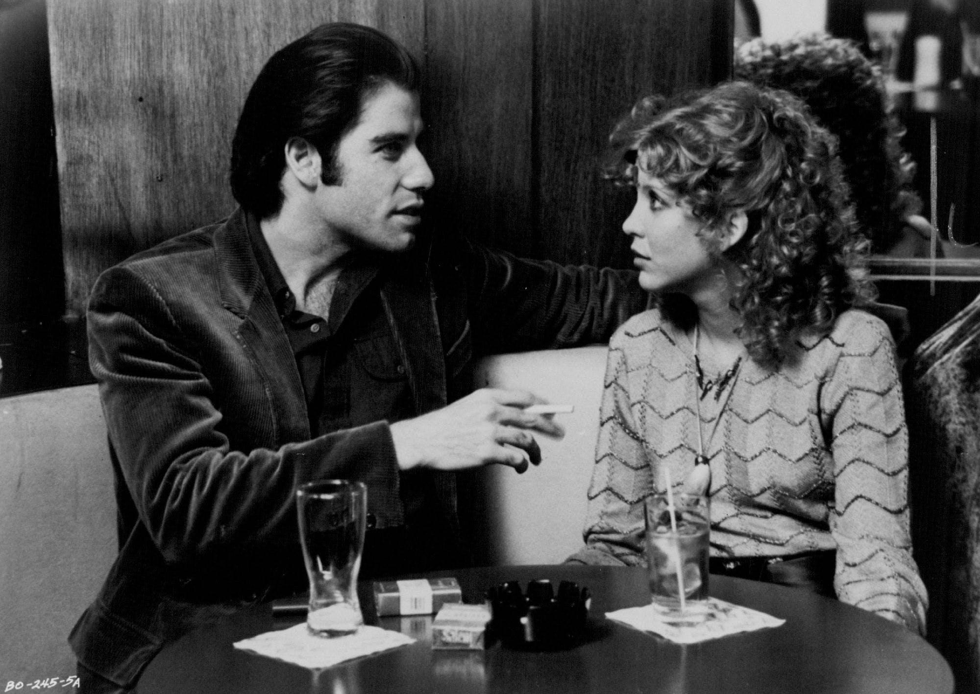 John Travolta and Nancy Allen in