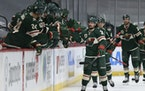 Minnesota Wild's Mats Zuccarello (36) high fives teammate on the bench in celebration after his goal against the San Jose Sharks, during the second pe
