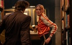"Karen Gillan as Sam in ""Gunpowder Milkshake."""