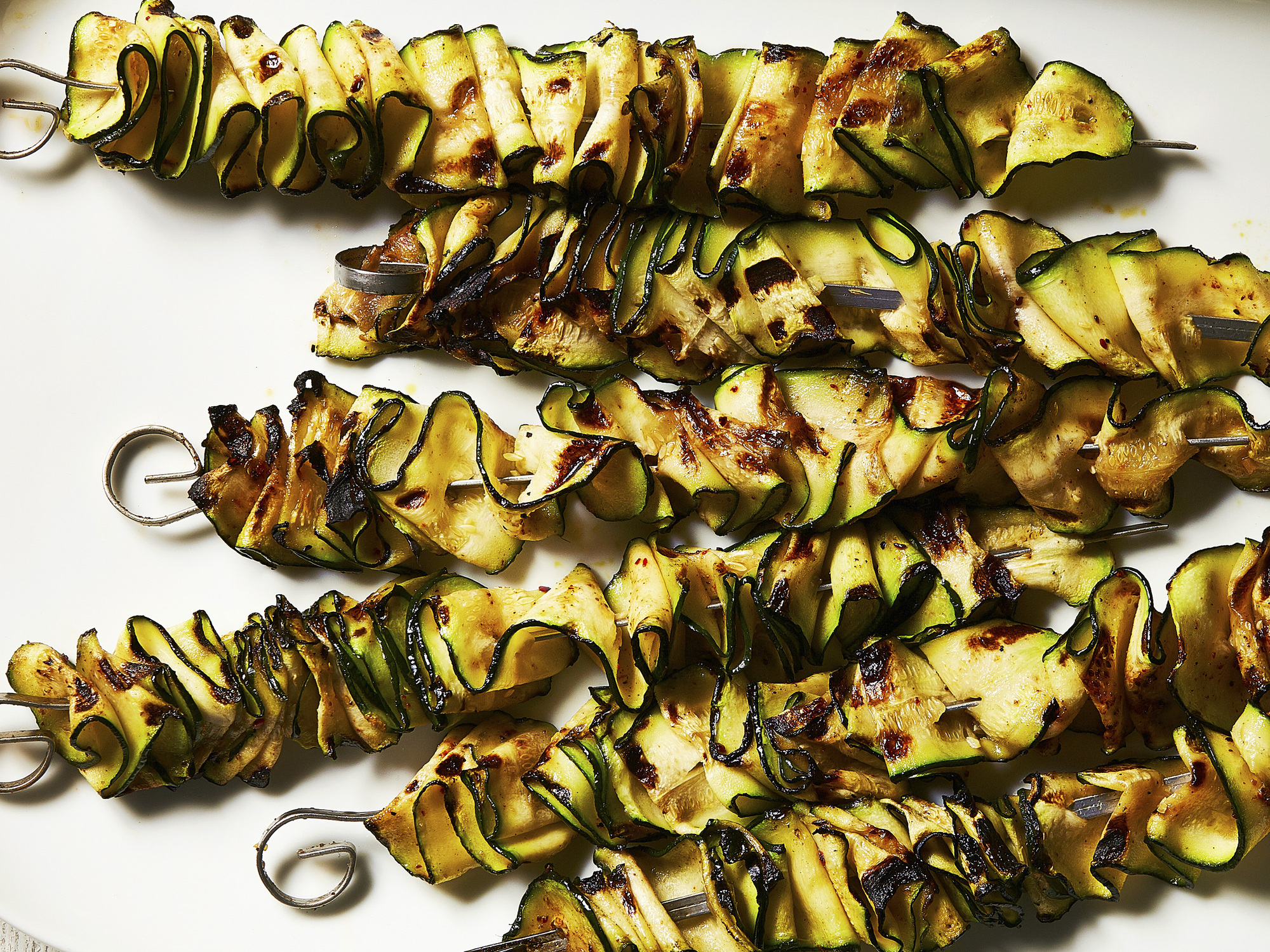 Grilled zucchini ribbons. Food styled by Roscoe Betsill.