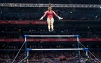 Suni Lee performing her signature move, the Nabieva, in the beginning of her uneven bars routine at the U.S. Olympic gymnastics team trials on June 27
