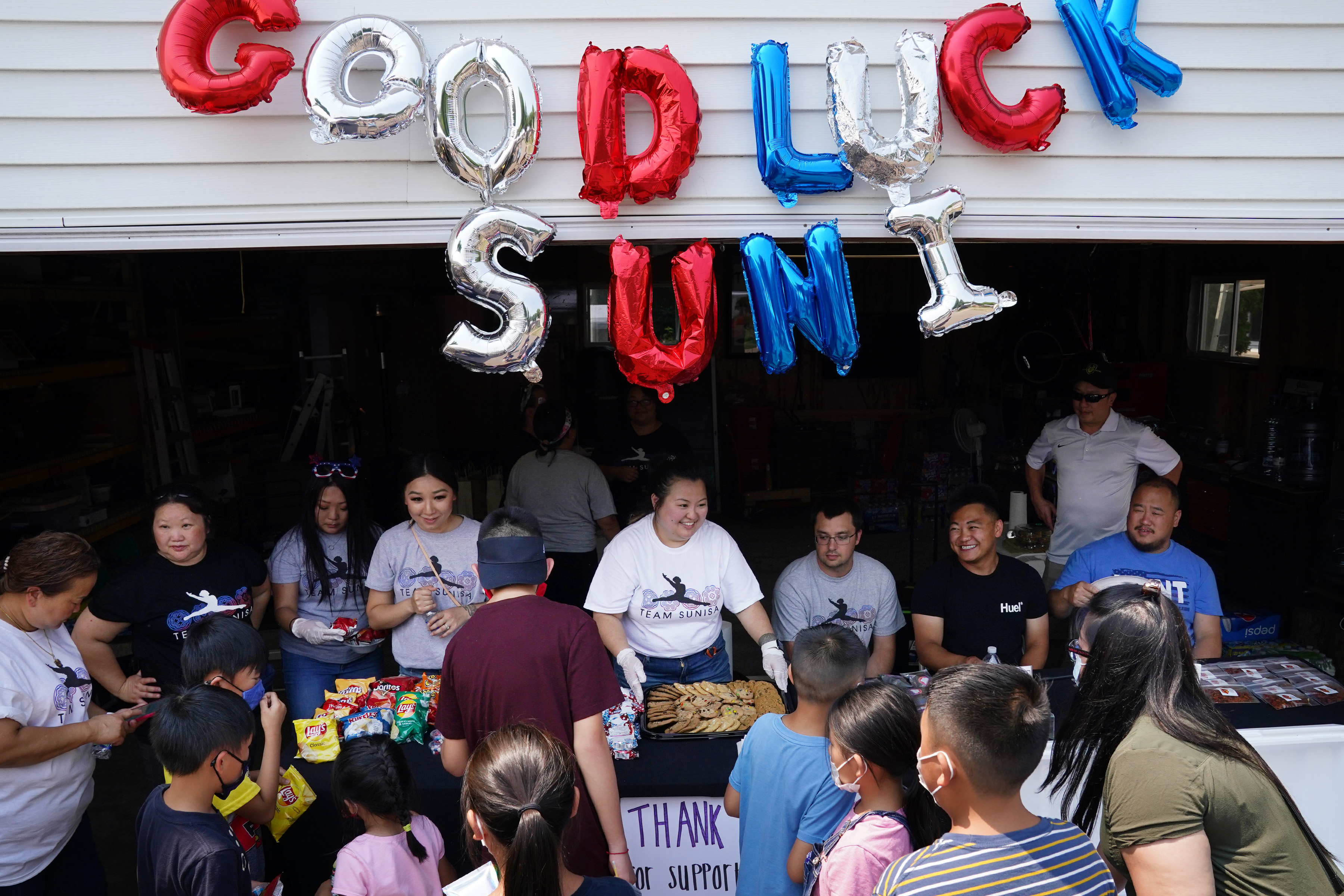 Friends and family of Olympic gymnast Suni Lee served drinks and snacks as they hosted a party in her honor on July 3.
