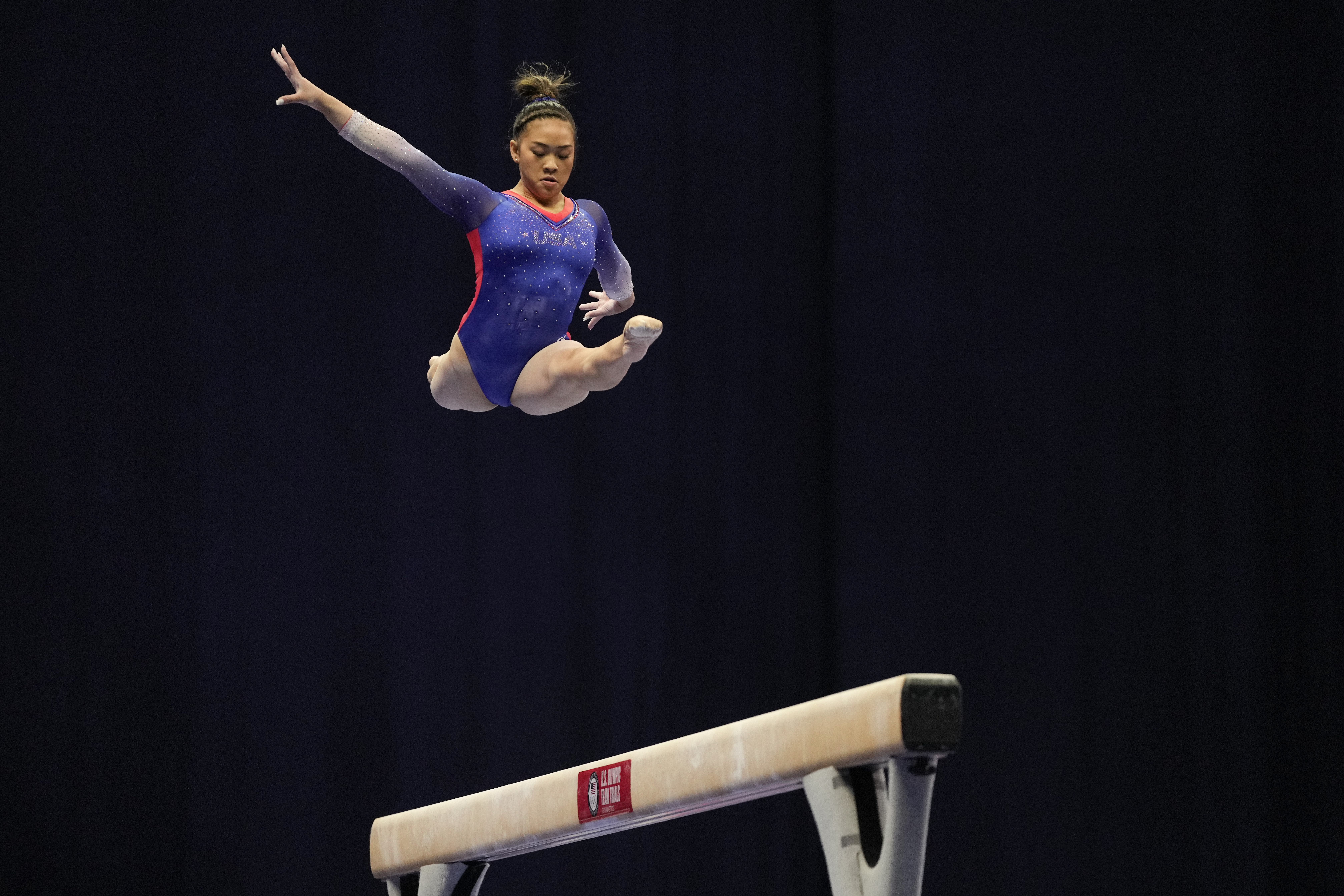 Suni Lee competes on the balance beam during the U.S. Olympic Gymnastics Trials on June 25 in in St. Louis.