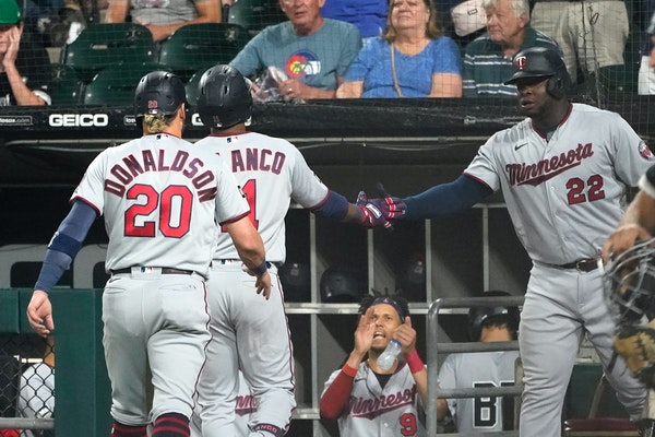 The Twins celebrate after Jorge Polanco's home run Wednesday night.