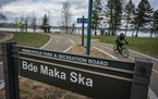 A sign for Bde Maka Ska near the south shore of the lake in 2019.