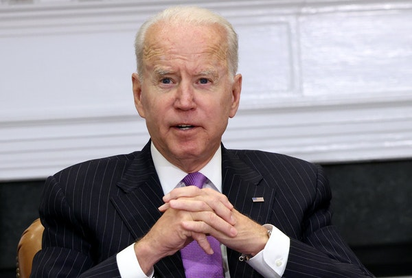 Biden insists U.S. 'following the science' on masks
